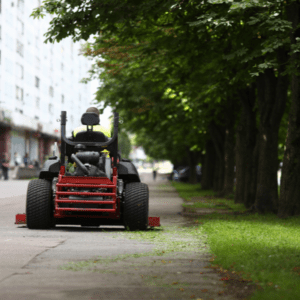 guy riding lawn mower at commercial place